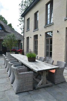"Alfresco dining at the Garnier estate ""Vaucelleshof"", custom oak table available at Garnier (be), image via the Garnier website as seen on linenandlavender.net"