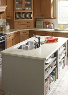 Kitchen storage shelves! Love this counter featuring Corian® solid surface.