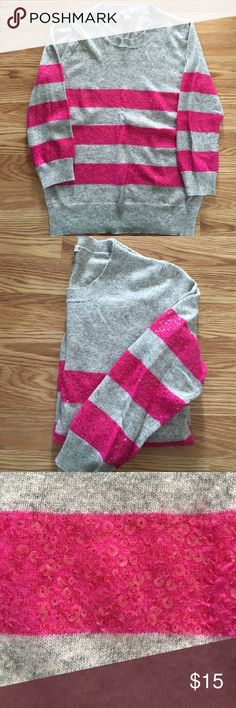 J.Crew Sweater with Sequins size small EUC. Only worn a couple times. Very soft gray sweater with pink stripes. Stripes on front and sleeves have sequins. 3/4 length sleeves. J. Crew Sweaters Crew & Scoop Necks