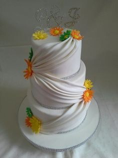 Elegant cream drapping bling daisy wedding cake created by MJ www.mjscakes.co.nz in sunny Hawkes Bay NZ delivered to Taradale RSA