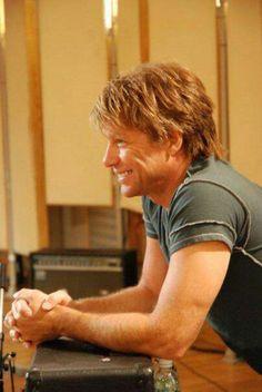 Jon Bon Jovi - smiling cutely in his studio