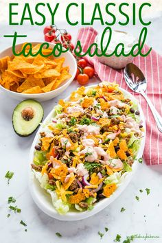 This easy Taco Salad recipe is easy to make and perfect for an easy meal or side dish - make it in under 30 minutes for a summer barbecue or a quick weeknight dinner! Recipe from thebusybaker.ca! #taco #tacosalad #tacotuesday #sidedish #summer #barbecue #potluck #mexican #texmex #easyrecipe #familymeal #weeknightmeal