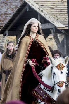 """Amy Bailey as Princess Kwenthrith (or Cwenthryth) of Mercia in """"Vikings"""" (2013-). Cwenthryth was the daughter of King Coenwulf of Mercia and sister of Saint Kenelm. She later became Abbess of Minster-in-Thanet, but was forced to resign by Wulfred, Archbishop of Canterbury."""