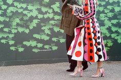 If you're going for a printed jacket (which, let's be honest, you want to be), don't shy away from a printed bag and detailed shoes, too. You've got this.Valentino coat. #refinery29 http://www.refinery29.com/2015/02/82710/london-fashion-week-2015-street-style#slide-34