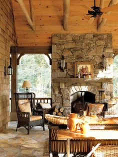 gorgeous home interiors / stone fireplace / log home interiors / rustic sun room