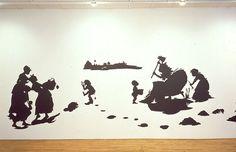 Kara Walker Room sized tableaux using black cut out paper 1994