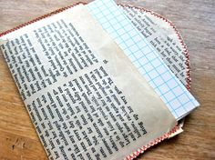 DIY Book Pages to Fabric Tutorial from Design Sponge. This is supposed to feel more like oilcloth that you can sew on. Really easy DIY using silicone to coat the pages. Sewing Basics, Sewing Hacks, Basic Sewing, Sewing Tips, Diy Projects To Try, Sewing Projects, Craft Projects, Diy Paper, Paper Crafts