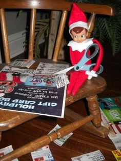 Elf on A Shelf cutting tons of coupons and making a mess of them. lol