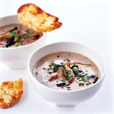 Wild Mushroom Soup with Parmesan Toasts | Grace Parisi created this recipe almost by accident. When she was cooking dinner for her kids, one of them knocked into her while she was adding a few tablespoons of chicken broth to a pan of sautéed mushrooms. She poured in a lot more broth than she intended to and ended up with a terrific mushroom soup.