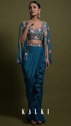 Kreetika Sharma In Kalki Teal Frill Draped Skirt With Embroidered Blouse And Cape Style Net Jacket Online - Kalki Fashion Indian Wedding Gowns, Desi Wedding Dresses, Indian Dresses, Indian Outfits, Draped Skirt, Slit Skirt, Skirt Fashion, Fashion Dresses, Lehenga Blouse