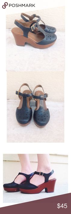 Leather black & brown vintage wedge platform clogs Leather black and brown vintage wedge platform. Super cute! Has a t strap with a brass gold buckle. Has cute detailing on the front. Super comfortable! Leather upper. Balance is man made material. These are in preowned condition. Size 6(36.5). An adorable touch to any outfit ✨ Kork Ease Shoes Platforms