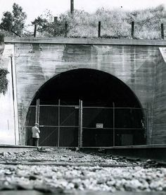 1956 - Locked gate on closed subway tunnel at 22nd Street and Glendale Blvd. in Los Angeles, in June 1956.  End of the Pacific Electric red trolley car era. Photo by Jack Gaunt, L.A. Times Archives Web:  http://www.framework.latimes.com