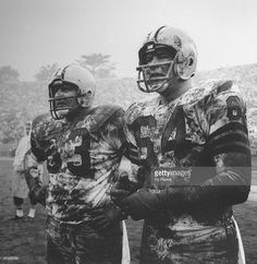 Green Bay Packers Fuzzy Thurston (63) and Jerry Kramer (64) on sidelines, covered in mud during game with rain, weather vs San Francisco 49ers, San Francisco, CA