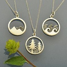 Wanderlust Charm Necklaces - Mountain, Ocean and Pine Tree. This great deal makes gift giving easy! You will receive three Ready to Wear Nature Inspired Necklaces - making these the perfect Best Friend gift set. Keep one for yourself and give the other two to your hiking buddies! Suspended from an 18 inch long Sterling Silver Italian Chain, these best sellers are sure to please. Oxidized detailing gives these cutout piece dimensions. Whether you like to ski, hike, swim, or go camping, these…