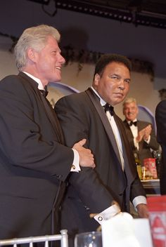 President William Jefferson Clinton at the Italian American Dinner at the Washington Hilton Hotel in Washington, DC. President Clinton stands with Muhammad Ali. 10/28/2000 ... The image was photographed by Sharon Farme