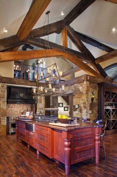 Love the high ceilings with balcony above. Exposed beams are great. Like flooring and stonework.