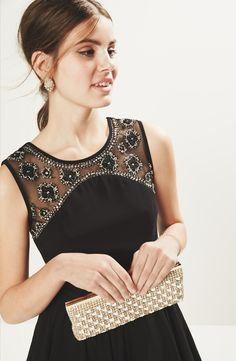 The gorgeous embellishments on this LBD make it perfect for Homecoming.