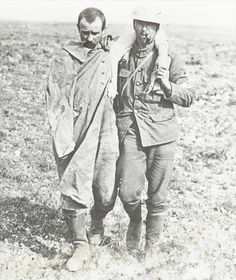 25 Sept 1916; British soldier helping a wounded German prisoner.