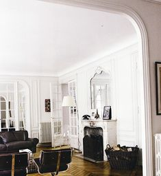 the hints of eras past add a wonderful texture to the room. the mirror/fireplace are beautiful.