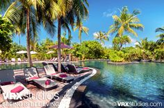 Beautiful tropical foliage surrounds the Fluid Jungle Pool of the #Hilton #Maldives. View more stunning photography here: http://www.vrxstudios.com