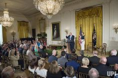 U.S. President Donald Trump makes remarks as his daughter Ivanka looks on during a Small Business event in the East Room of the White House…