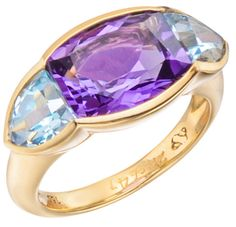 "Seaman Schepps Amethyst & Blue Topaz ""Avenue"" Ring. ""Avenue"" dress ring in 18k yellow gold, with faceted amethyst and faceted blue topaz side stones. Numbered and signed by Seaman Schepps.  Via 1stdibs."