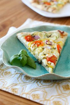 Garden veggie pizza.  The recipe had me at the homemade garlic and red pepper infused olive oil, but it's also a great way to use up zucchini!  I added shrimp which was very tasty. #CSA #zucchini