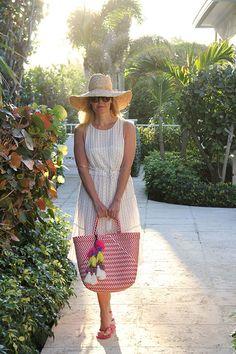Ridgely Brode, dressed in a lightweight sun dress, enjoys a warm beach day during her Spring Break on her blog Ridgely's Radar