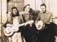"""Thanks to an intrepid park ranger who became a part-time folklorist, an archive of sound recordings and lyric sheets bears witness to a tradition that could well have died off. """"Fiddlin'John"""" Sharp (center) seen here with daughter Evelyn and banjo player Red Morris, is among the many musicians whose stories and songs are documented in Bobby Fulcher's archive."""