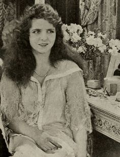 everybody's sweetheart - 1917 Olive Thomas in Indiscreet Corinne. Olive wears a lace negligee over her nightgown.