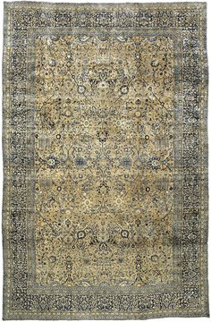 An early 20th century Persian Kirman (Kerman) carpet, the abrashed dusty pink field with an allover trellis of swirling vines and flowerheads within a dense midnight blue palmette and vinery border. Watch full size video of A Persian Kirman carpet, Circa 1910, ID BB3478 - Video