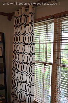 Chain Link stencil on fabric curtains.