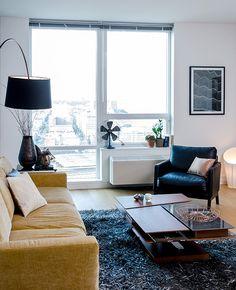 BoConcept Carlton sofa, Barcelona coffee table, Kuta lamp, and Monte chair