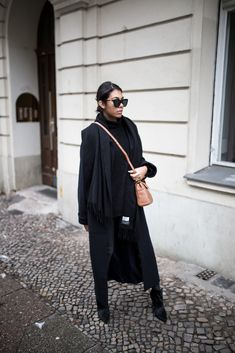 storm wears all black look with a brown coccinelle bag and les specs sunnies and zara booties