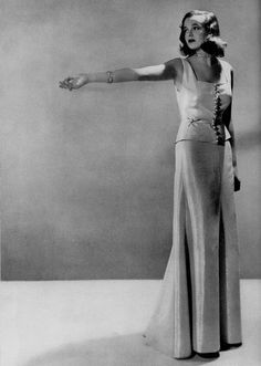 Man Ray | December 1936 | Actress Mary Rogers is wearing a two-piece lamè evening dress. thanks to skorver1