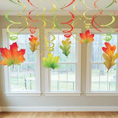 Add these festive Fall swirl leaves hanging from ceilings, doorways and more! Each package contains six - leaf danglers and six green, gold and red twirls.