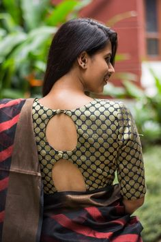 Buy House Of Blouse Black gold polka brocade blouse online in India at best price.Another festive brocade blouse in a cool polka dotted black gold! In an ever so popular boatneck style Blouse Back Neck Designs, New Blouse Designs, Stylish Blouse Design, Saree Blouse Designs, Brocade Blouse Designs, Mirror Work Saree Blouse, Sari Bluse, Latest Saree Blouse, House Of Blouse