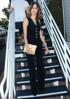 Monochrome: The model looked chic in a black best and matching wide-leg trousers