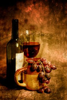 wine glass grapes and jug in portrait format and an oil painting
