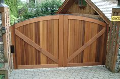 Don't let this wood gate fool you. It's actually a single swing gate that gives…