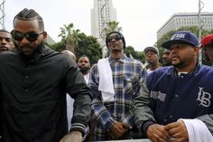 Snoop Dogg and the Game led a peaceful march Friday to Los Angeles Police Department headquarters, where they urged improved relations between police