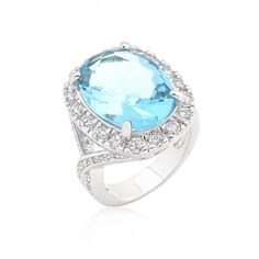 Genuine Rhodium Plated Blue Topaz Oval Cocktail Ring with Faceted Blue Topaz Center Cubic Zirconia and Clear Cubic Zirconia Accents in a Prong Setting Polished into a lustrous silvertone finish #mycustommade