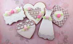 White wedding cookies with lace and roses. Wedding dress and decorated hearts and label