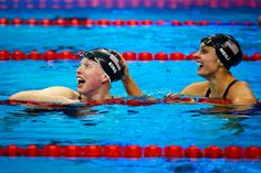 Lily King celebrates winning gold with Kate Meili in the Women's 100m Breaststroke Final on Aug. 8, 2016. ((Photo by Adam Pretty/Getty Image))
