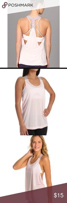 Alo Raya Draped Back Tank Color: Blush/Moonstone Draping panes of fabric form the back of a made-to-layer tank cut loose and long for a comfortable session on the mat. Wide elastic straps converge at the athletic racerback. ALO Yoga Tops Tank Tops