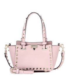 Valentino - Rockstud Micro leather tote - Flawlessly finished in muted pink leather, Valentino's Rockstud Micro tote is updated for the new season. The signature Rockstud embellishment in pale gold-tone adds maximum impact. Carry it from dusk till dawn with sharp tailoring and dressed-down denim. seen @ www.mytheresa.com