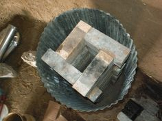 Rocket Stove Heat Riser... photostream of Year-of-Mud's rocket stove construction
