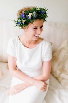 Bride wears a blue and white wildflower crown. Images by by laria Petrucci Photography