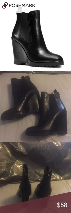 """Michael by Michael Kors wedge booties black 5M A lugged platform sole toughens a casual bootie styled with a slim wedge heel and curvy almond toe. - 4 1/4"""" heel; 4 1/2"""" boot shaft (size 8.5) - Pull-on style - Elastic side goring - Padded insole - Leather or suede upper/textile lining/rubber sole Additional Info Runs small; order 1/2 size up. In Great condition, some sticky residue from tags on the inside and outsole, Sorry no trades or modeling. Thanks for looking. MICHAEL Michael Kors Shoes…"""