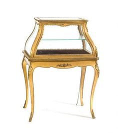 * A Louis XVI Style Gilt Metal Mounted Vitrine, late 19th century, retailed by r.j. horner,